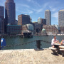 Two men enjoy a lunch break on the Harborwalk. (Photo by Baylee Wright)